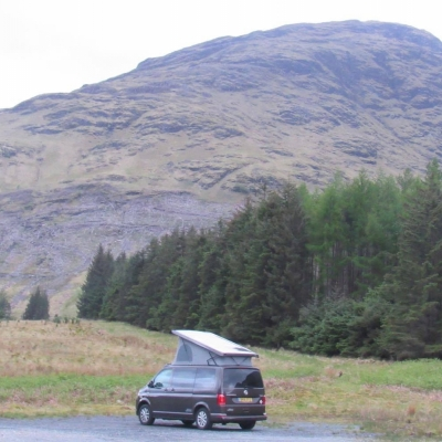 VW Campervan with mountains in the background