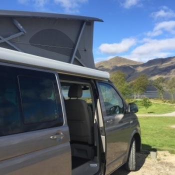 VW Campervan Hire with view of hills in Scotland