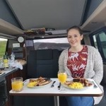 Happy Customers enjoy Breakfast in the campervan at Four Seasons Campers