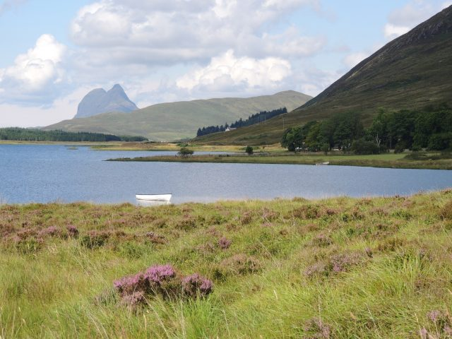 Tour around Scotland in a campervan and drive the NC500 and Loch Assynt beside Suilven mountain
