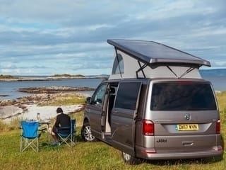 Happy campers camping at Arisaig in campervan